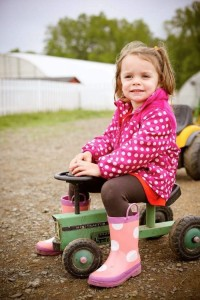Kaia Gallagher on pedal tractor by Photography by Jen Davis