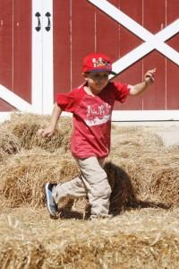 boy hay bale