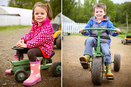 Kids on pedal tractors