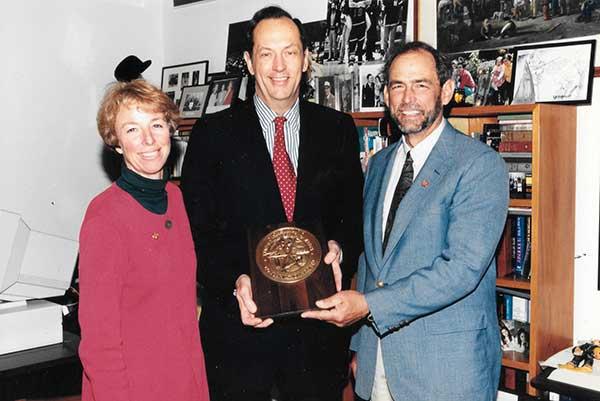 Pam and Gary receive award from Senator Bill Bradley